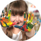Little girl's hands covered with different kinds of paint