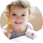 Little girl holding a pen