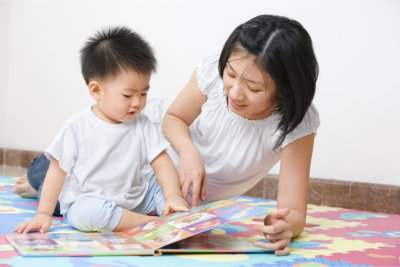 Woman teaching the baby
