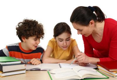 Woman teaching the 2 kids